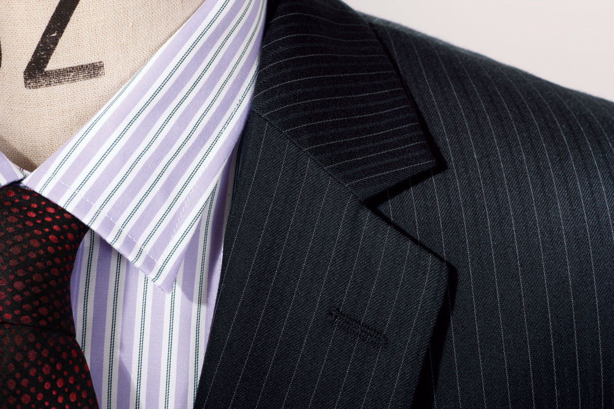 Men's Pinstripe Suit, with varieties such as a business suit, two-piece suit, and three-piece suit or lounge suit consist of a set of matching clothing consisting of: A coat commonly known as a jacket, A pair of trousers, Optionally, a waistcoat (USA vest).